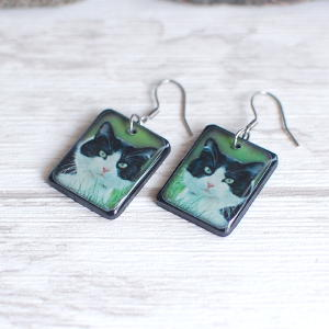 Black and White Cat Earrings on green background 2