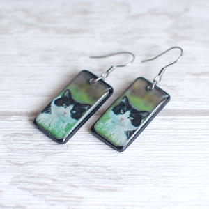 Black and White Cat Earrings on green background 1
