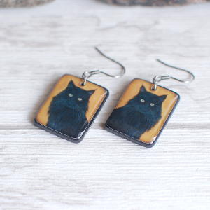 Black Cat Earrings Black on yellow background