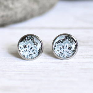 Stud earrings Lace white on black background