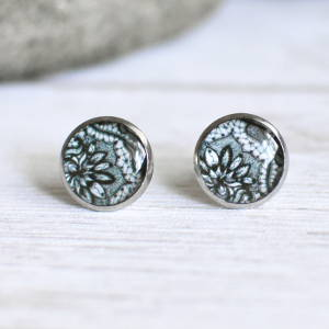 Stud earrings Lace black on white background