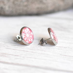 Stud earrings Snowflake on a pink background