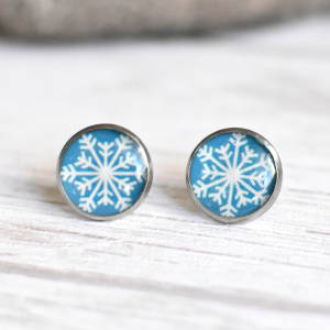 Stud earrings Snowflake on a blue background