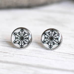Stud earrings Snowflake on a white background